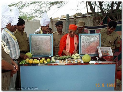 A fridge donated by Shree Swaminarayan Gadi Sansthan is blessed by Acharya Swamishree