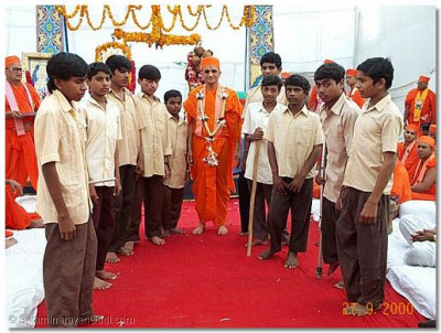 Members of amusic band entirely comprising of disabled children who ormed to His Holiness Acharya Swamishree.