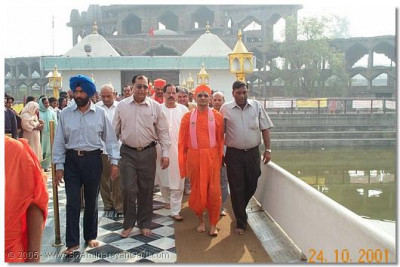 HDH Acharya Swamishree is given a guided tour by the hosts