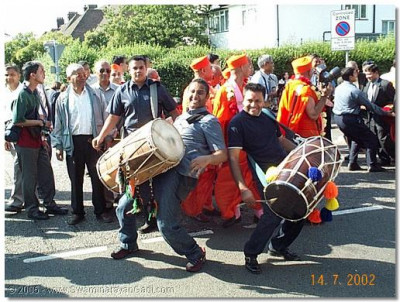 Dhol players please Lord Swaminarayanbapa Swamibapa during the procession
