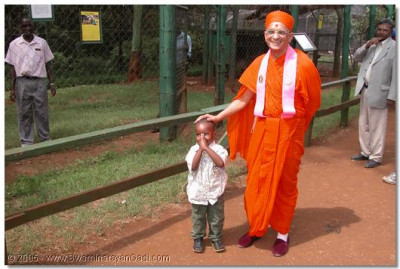 HDH Acharya Swamishree blessing a young child at Nairobi's National Park