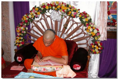 Acharya Swamishree performing His daily niyam of writing mantras