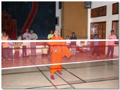 On 27th December 2003 His Divine Holiness Acharya Swamishree gives His divine darshan whilst playing badminton during the indoor games held at the Swamibapa Educational and Cultural Hall, Nairobi