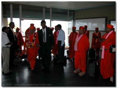 His Divine Holiness Acharya Swamishree and the sant mandal fulfil the prayers of the devotees residing in Uganda, and arrive at Kampala Airport on 2nd of January 2004