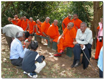 Sants and devotees gather in the presence of Acharya Swamishree before departing for the residential lodge
