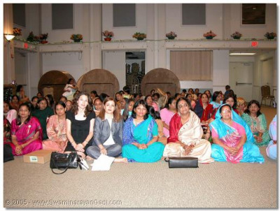 Wife of the UN Ambassador seated with disciples