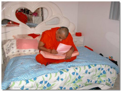 HDH Acharya Swamishree writing His daily mantras
