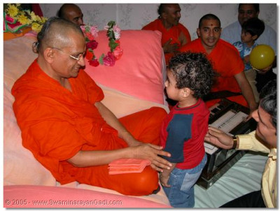 HDH Acharya Swamishree blesses a young disciple