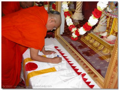 Acharya Swamishree blessing the flag that will be raised outside the London temple