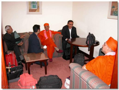 Acharya Swamishree in the VIP departure lounge at London's Heathrow Airport before boarding the plane to New York, USA
