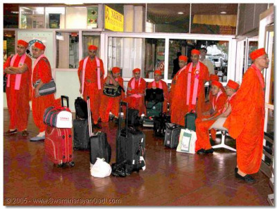 The sants await at Nairobi airport for their flight to Uganda