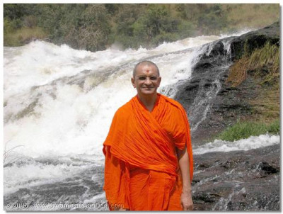 Acharya Swamishree gives darshan besides the river