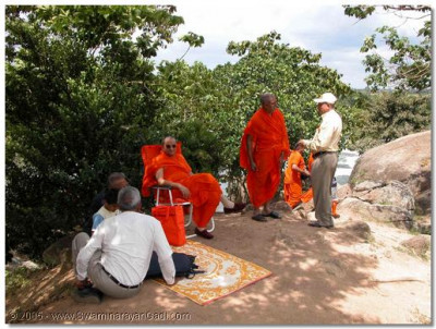 Acharya Swamishree rests under the shade of a tree, at Lake Victoria