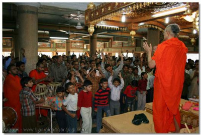 Acharya Swamishree delights the disciples by joining in with the rejoicing