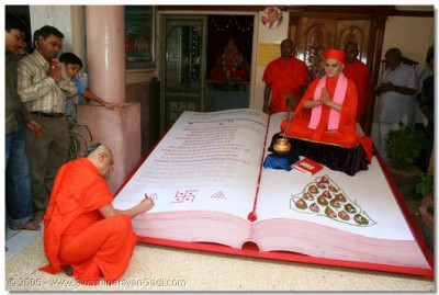 Acharya Swamishree signs a special accounts book; that which contains the facts of each disciple's obedience and disobedience of the Lord's commands