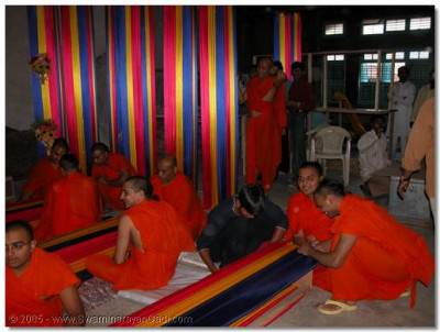 Sants and devotees preparing hindolas for the fooldolotsav celebrations