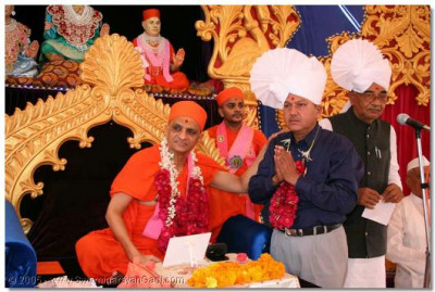 The President of the Patel Samaj, Shree D D Patel is blessed by Acharya Swamishree