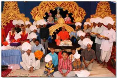 Disciples on whose behalf the recital of the divine scripture, Shree Swaminarayan Gadi were held, bring gifts to offer to the Lord