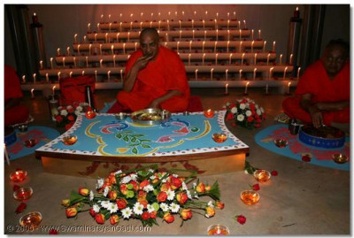 A special rangoli had been made where Acharya Swamishree and each sant were to dine