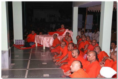 Acharya Swamishree and sants view the religious drama production