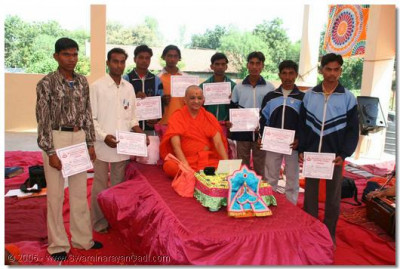Students of our University who excelled in various fields are presented with awards by Acharya Swamishree