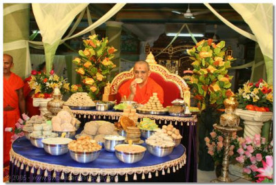 Acharya Swamishree having some prasad thar