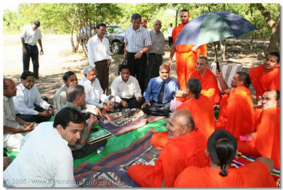 Acharya Swamishree in overseeing the organising of the Ground Breaking Ceremony with sants and devotees
