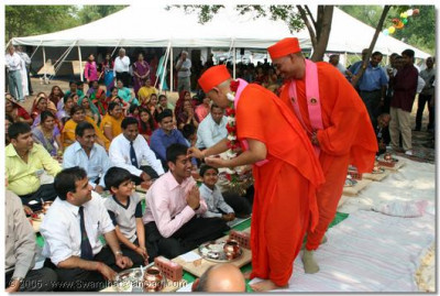Devotees are blessed by Acharya Swamishree