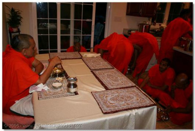 3rd June 2005. After the previous day's Ekadashi fast, Acharya Swamishree and sants have some prasad in the morning before returning to New Jersey.