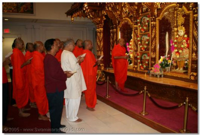 Acharya Swamishree, sants, and devotees take thier vows in front of Lord Swaminarayan