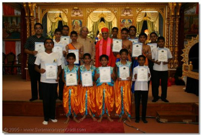 Music students receive achievement certificates from Acharya Swamisheee