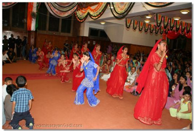 Traditional Indian dance performed by young devotees to the kirtan 'O Swamin pyaare.......'