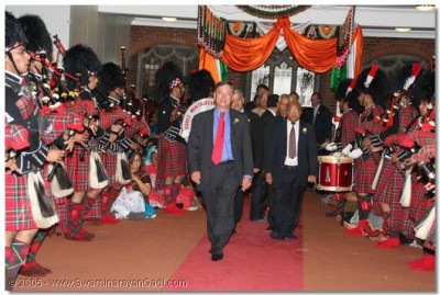 Shree Muktajeevan Pipe Band give a guard of honour to the guests