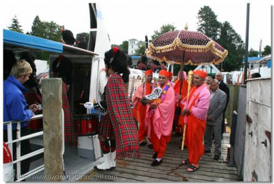 The procession arrives at the dock at Lake Windermere