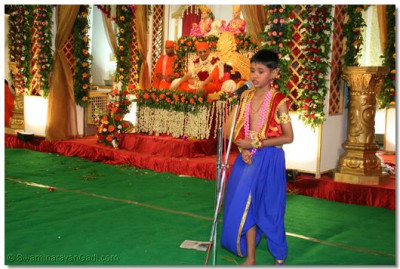 Speech being given by a young devotee