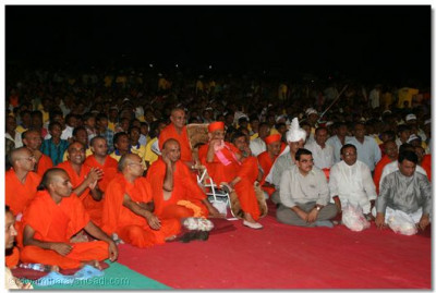 Acharya Swamishree, sants and disciples watch the devotional dance performances