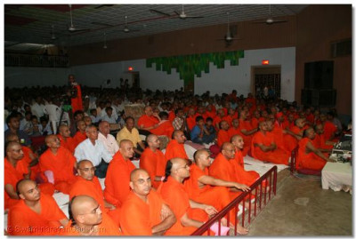 Acharya Swamishree, sants and devotees watch the performances