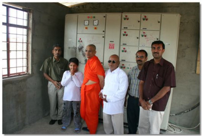 Acharya Swamishree blesses a dicisple's factory in Arusha