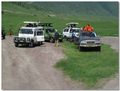 Sants and devotees board the vehicles for the wildlife tour in Ngorongoro Crater