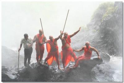 Some of the sants give darshan under the waterfall
