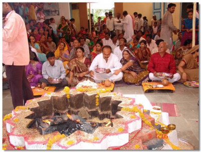 Disciples take part in performing the Hari-jap-yagna ceremony