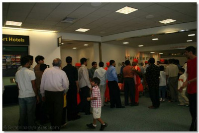 After a long journey from India sants arrive at New York's JFK International airport