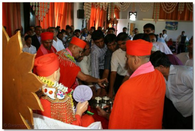 Acharya Swamishree and disciples perform panchamrut snan - ceremonial bathing with the five nectars.