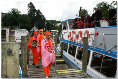 Acharya Swamishree and sants prepare to board a boat to commence a cruise on Lake Windermere