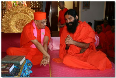 Swami Ramdevji humbly prays for the blessings of Acharya Swamishree