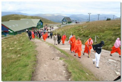 Sants and devotees walk up the mountain trail
