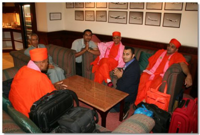 Acharya Swamishree and sants give their divine darshan in the departure lounge at Heathrow International Airport