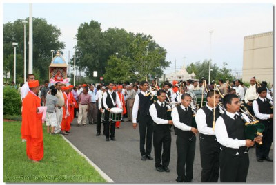 The procession approaches the temple