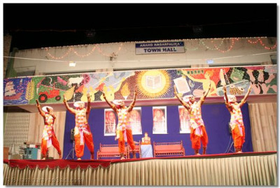 Sants perform a devotional dance during the special concert held in Anand's Town Hall