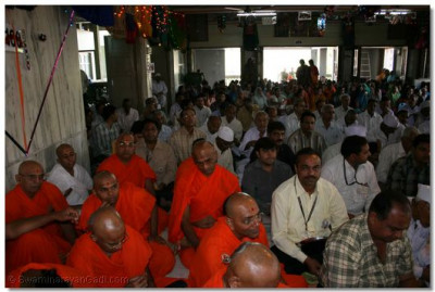 The temple was packed with disciples during the ceremony